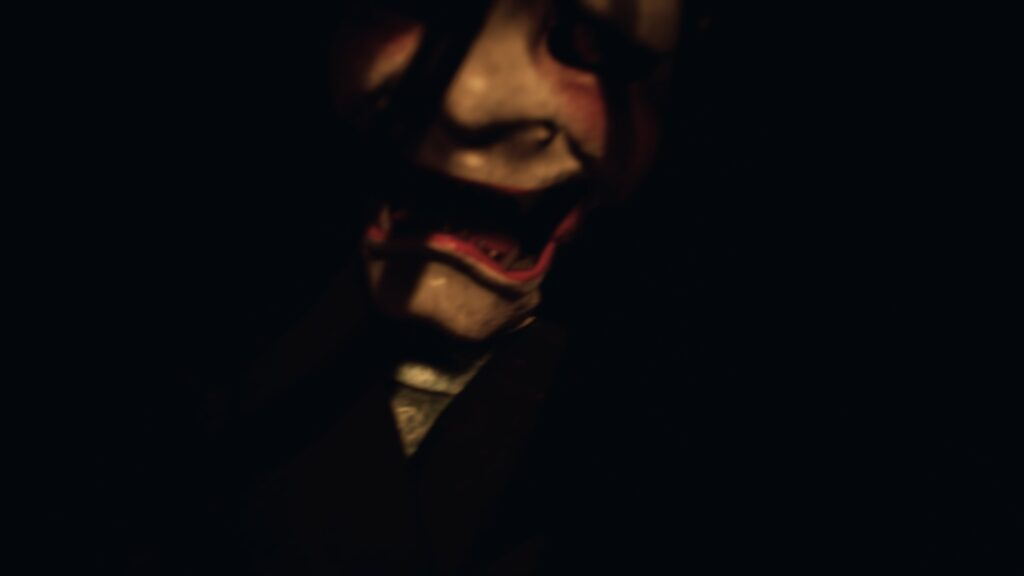 Ikai Key Art Scary Face in the Darkness